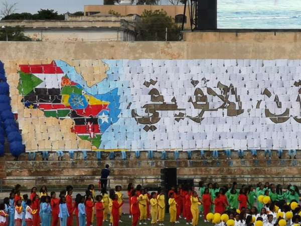 A symbol of East African friendship made up of human pixels during the Independence Day show of Eritrea
