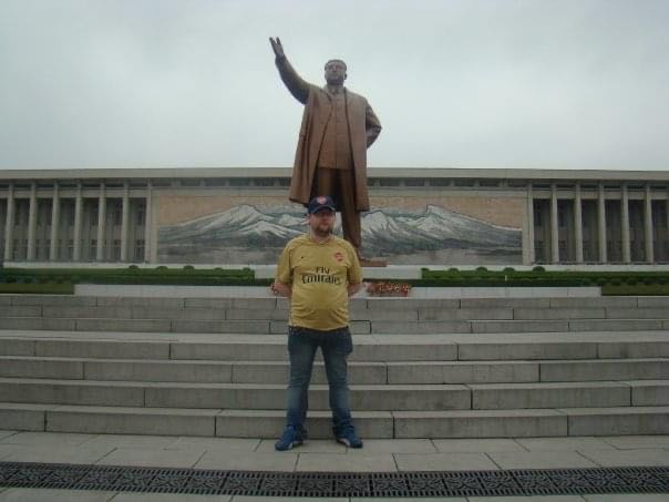 Gareth Johnson in front of the statue of Kim Il Sung on his first tour of North Korea