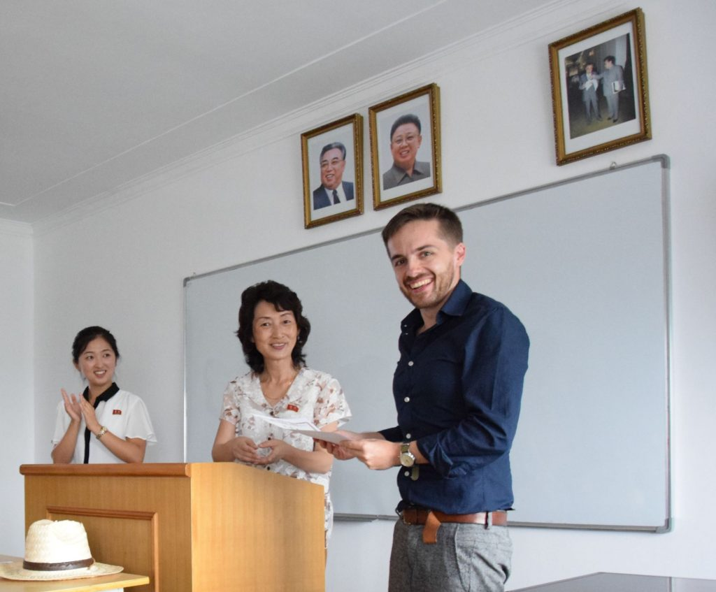 Simon with his teacher as he was studying in North Korea
