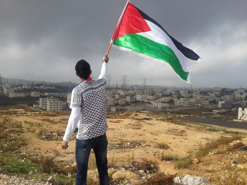 Man with a Palestinian flag