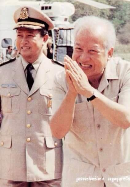 Norodom Sihanouk and his son inspecting forces