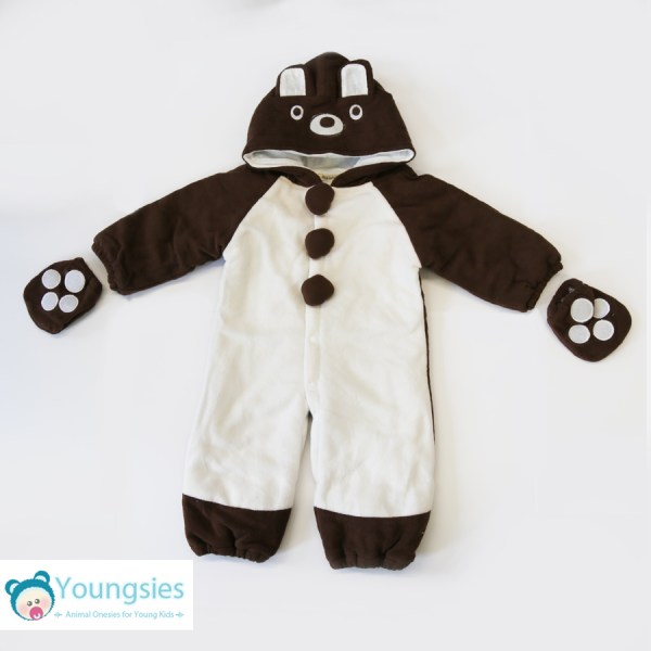 Full shot, brown and white bear romper suit