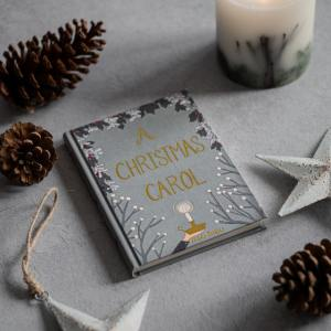 Book cover reading A Christmas Carol, with christmas decorations