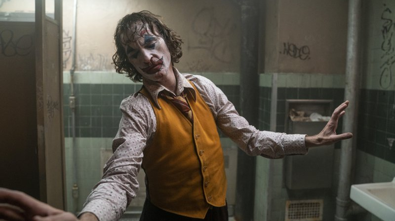 "This image released by Warner Bros. Pictures shows Joaquin Phoenix in a scene from ""Joker."" On Monday, Jan. 13, the film was nominated for an Oscar for best picture. (Niko Tavernise/Warner Bros. Pictures via AP)"