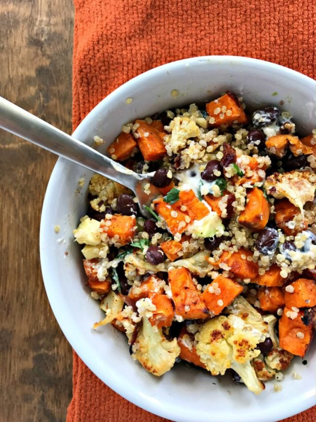Roasted Sweet Potato & Cauliflower Power Bowl with black beans and quinoa. A bowl full of plant protein, fiber, and plenty of flavor!