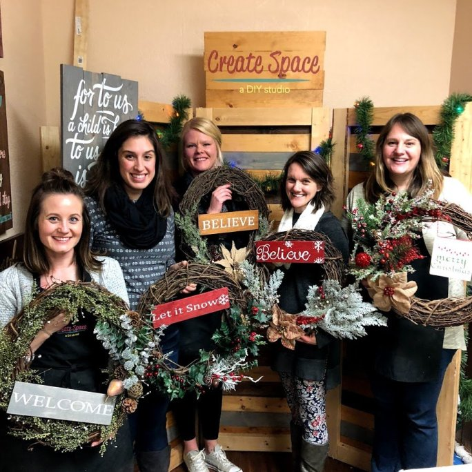 Customers with finished wreaths