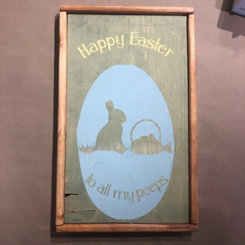 Framed wood sign with the phrase Happy easter to all my peeps and a grphic of an easter egg with a sihouette of an easter bunny and basket on grass