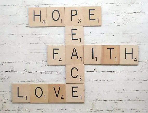 A crossword lwayout of the words Hope Peace Faith and Love arranged using intersecting letter tiles.