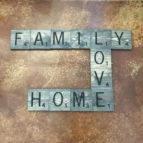 Crossword arrangement of letter tiles spelling out the words family, love and home
