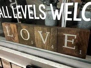 Wooden letter tile blocks that spell the phrase love