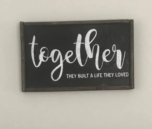 Framed wood sign with the phrase together the built a life they loved