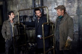L-R: Hal, Tom, and Weaver discuss the plan next to the very volatile bomb