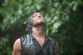 Daryl enjoying the rain shower. Too bad no one had a bar of soap.