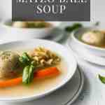 matzo ball soup in a white bowl on top of a white plate
