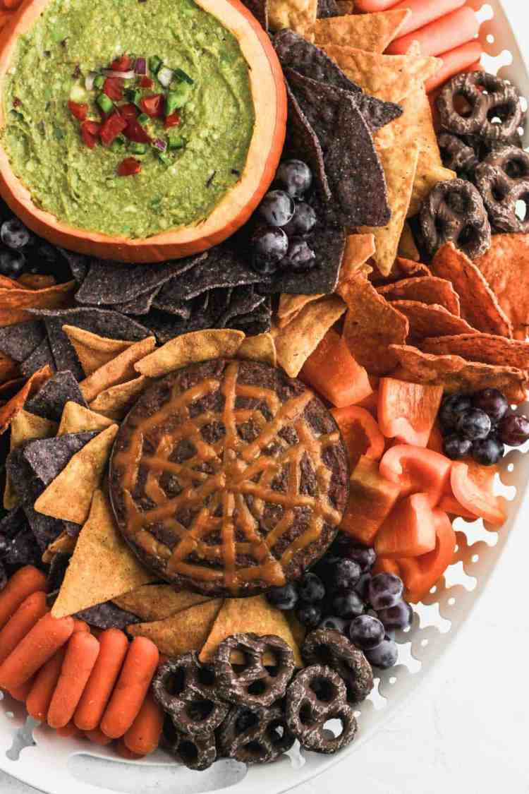The bottom portion of the halloween snack board to show the spider web design on the black bean dip.