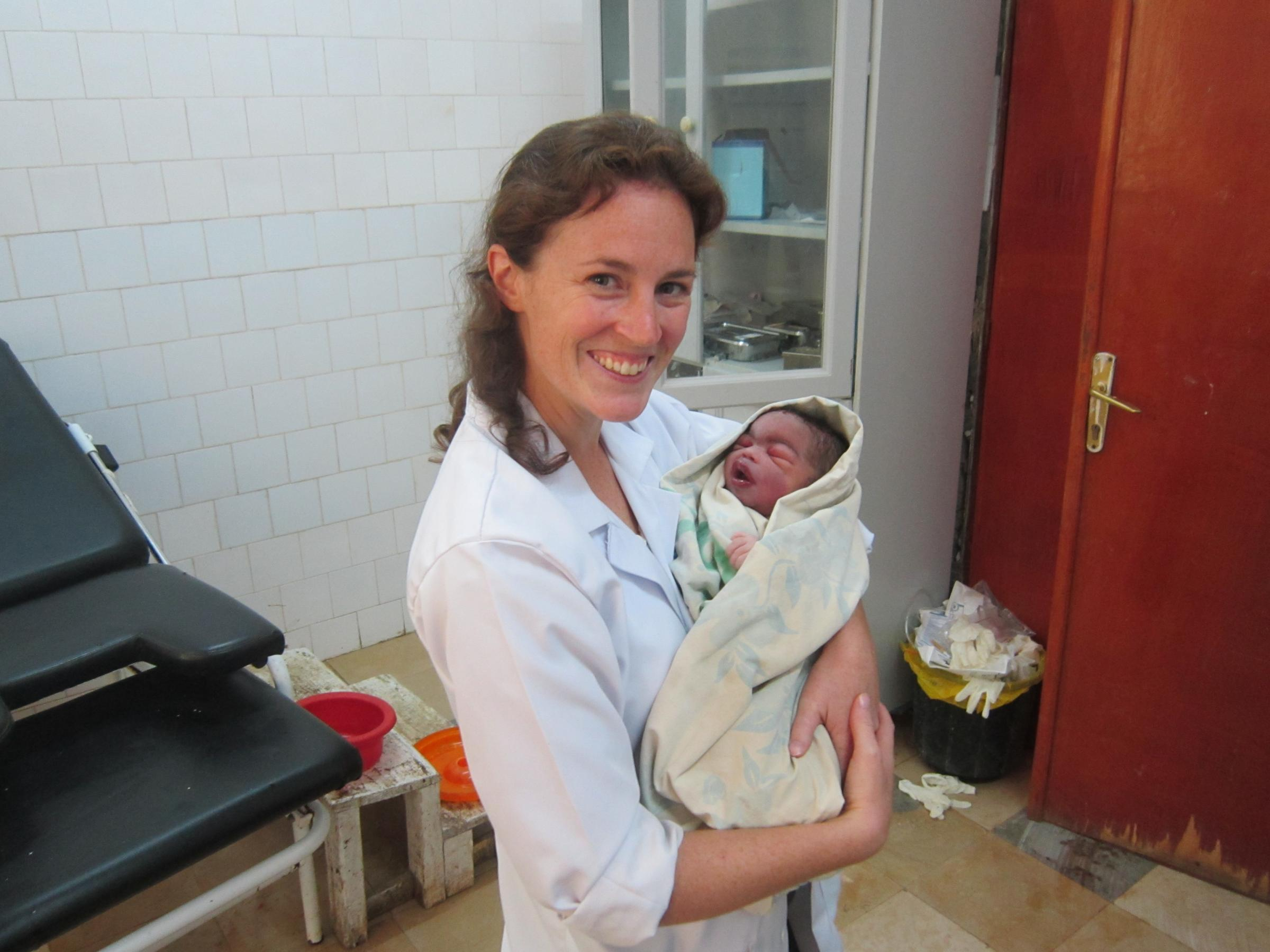 Dr Alexa Vardy with a newborn (Credit: Your Local Guardian)