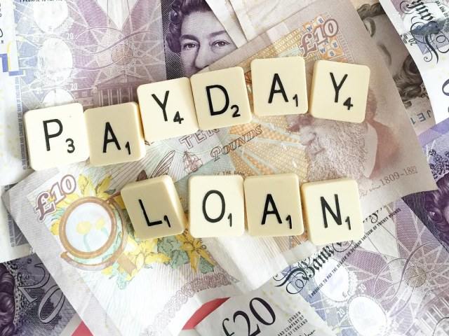 payday loan in scrabble tiles and GBP notes