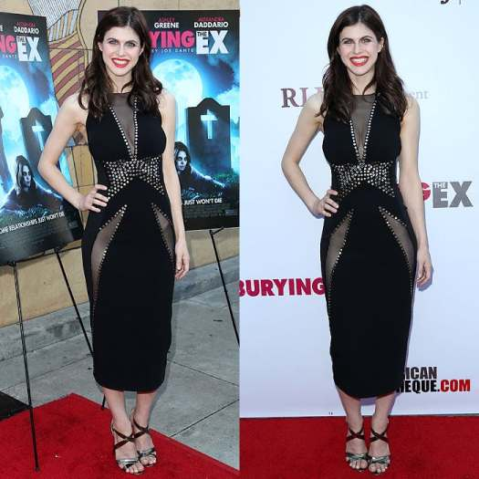 Alexandra Daddario in a Donna Karan dress with sheer panels that reveal her cleavage and hip bones