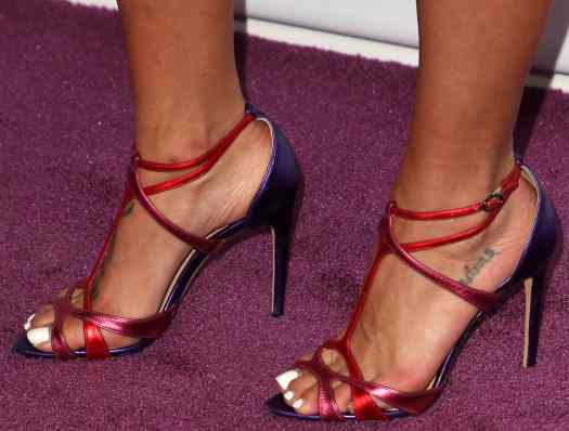 Jessica Szohr'snaked feet with mysterious tattoos