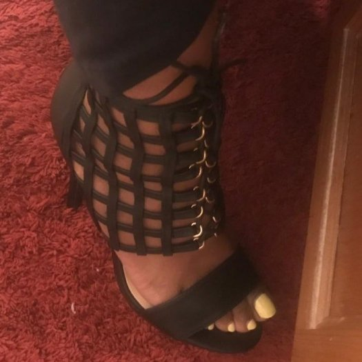Sexy caged platform heeled sandal with front lace-up detail and back zip closure.