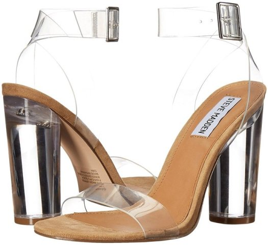 Translucent straps and a towering column heel evoke the delicacy of a glass slipper in this barely-there ankle-strap sandal with standout style