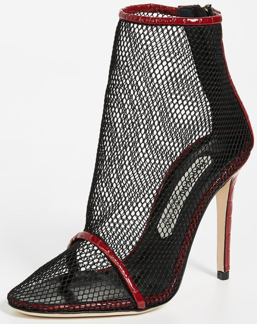 Croc-embossed patent leather and sheer mesh make a daring and edgy pairing on this pointy-toe bootie from Nicole Brundage's Marskinryyppy