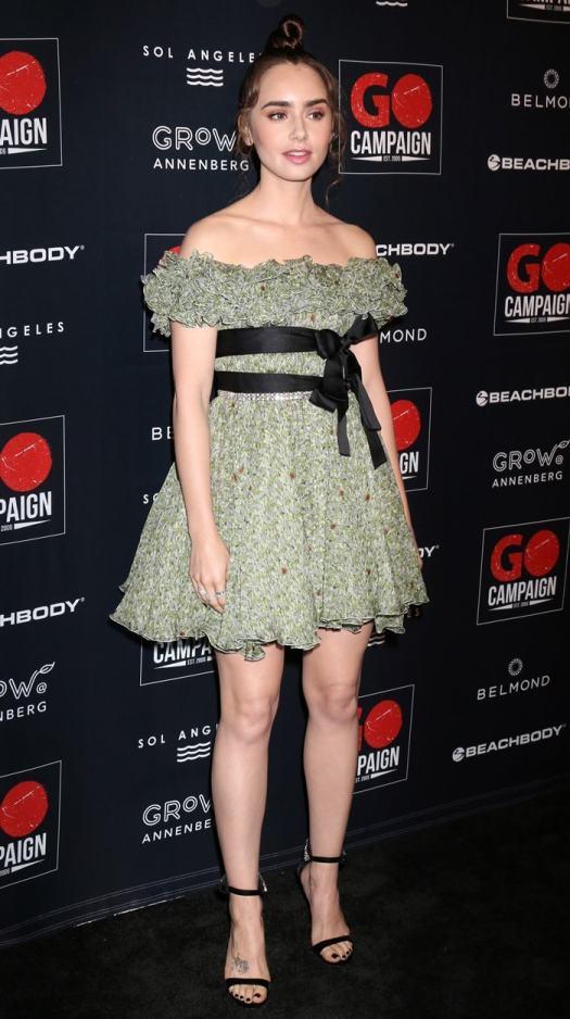 Lily Collins wearing anoff-the-shoulder mini dress byGiambattista Valli