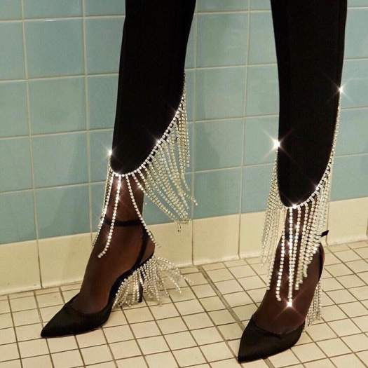 Crystal-embellished pants paired with fringe heels from AREA