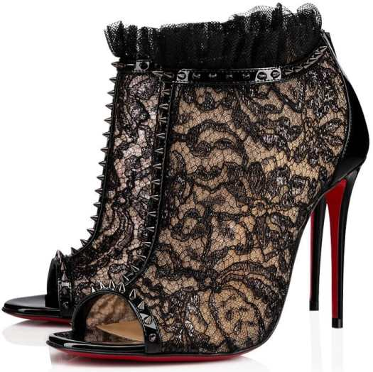 Crafted in black calfskin, glossy lace and tonal tulle, it is mounted on a 100mm stiletto for a developed arch