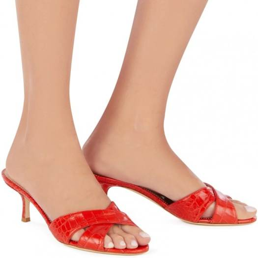 These criss-cross sandals are made from alligator-print leather in flame red.