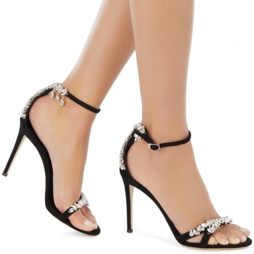 Black suede Lynette sandals fasten with an ankle strap and are adorned with sparkling rhinestones