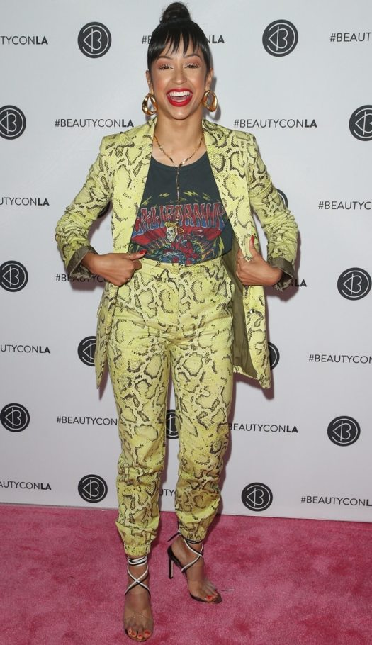 Liza Koshy wears a patterned neon yellow suit at 2019 Beautycon Los Angeles