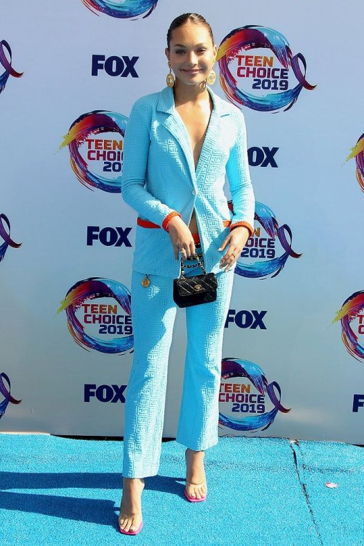 Maddie Ziegler in a sky blue vintage Chanel suit