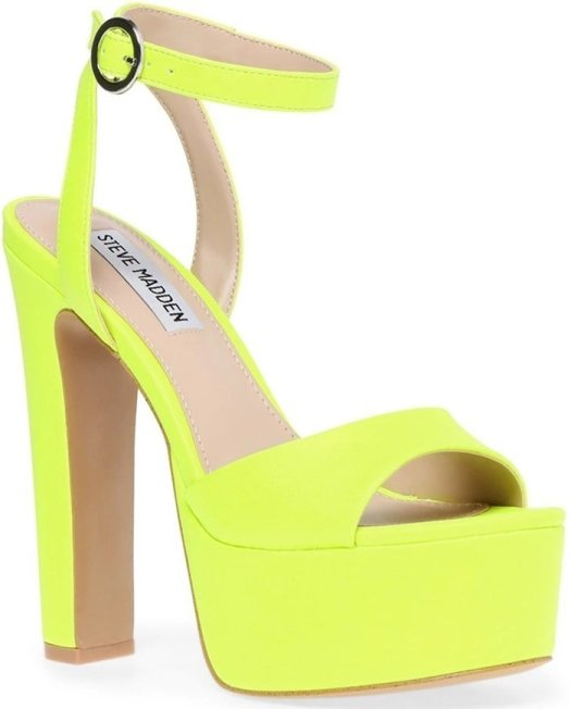 A lofty platform amplifies the retro appeal of this standout neon yellow ankle-strap sandal