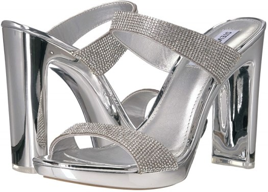A translucent platform and heel lend a dancing-on-air effect to a sandal secured with two clear bands