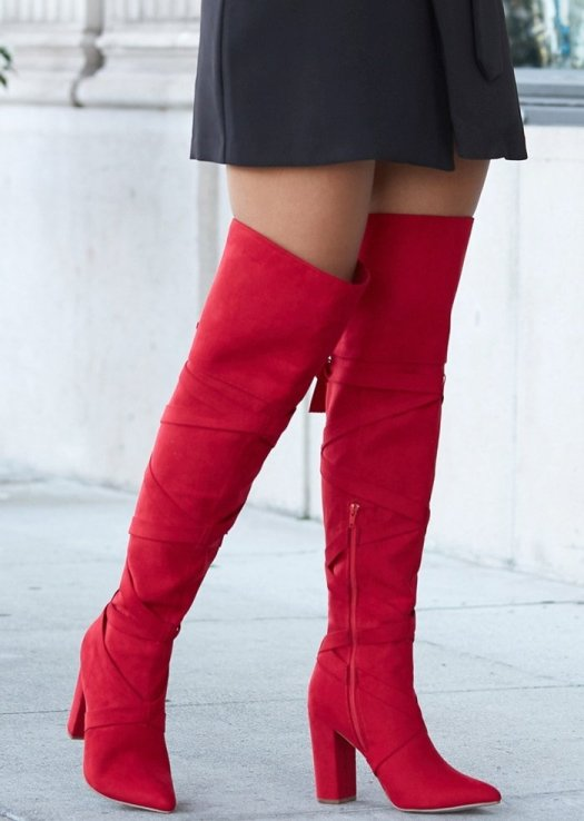 Classic thigh-high heeled boot with wraparound ties and a bow detail on the back