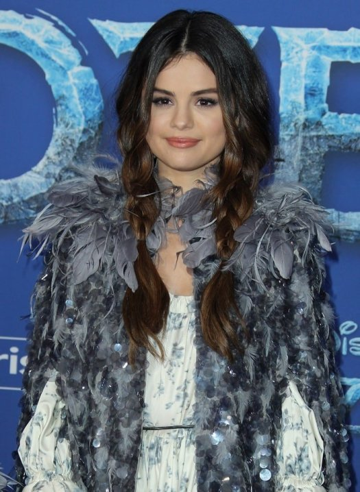 Selena Gomez wears braided pigtails with a look from the Marc Jacobs Fall runway