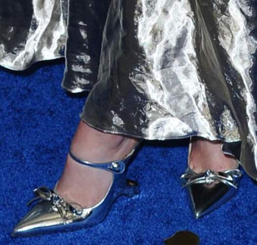 Joey King teams her silver dress with metallic silver Prada mules