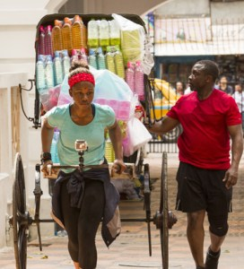 Simi Fagabongbe and Ope Fagabongbe navigate the crowed streets of Kolkata India on the Amazing Race Canada