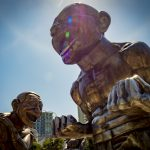 Laughing Sculptures in Vancouver by Yue Minjun
