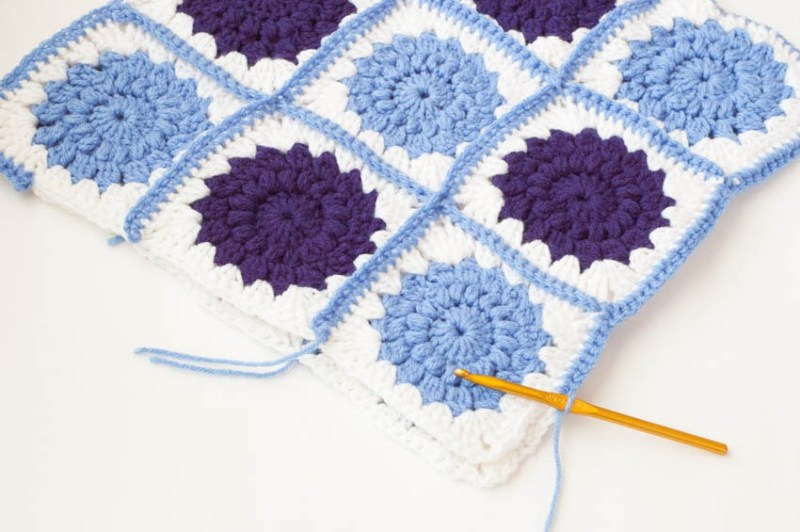Crocheted Sunburst Pillow | YouShouldCraft.com