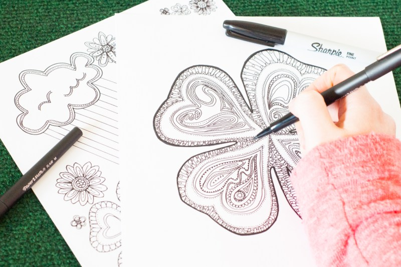 Love to color while listening to podcasts or audiobooks? Download two FREE adult coloring pages for St. Patrick's Day!!