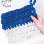 "blue and white crocheted potholder on a white background, with the text ""free crochet pattern: color block potholder"""