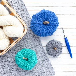 three different sizes of double twist crochet pumpkins