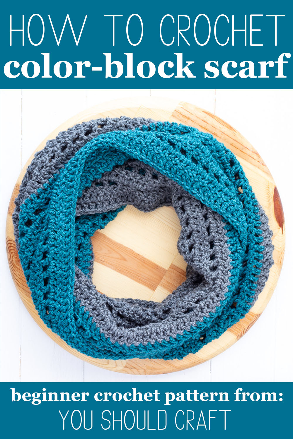 """wooden cutting board with a teal and grey infinity scarf and text """"how to crochet color-block scarf - beginner crochet pattern from: you should craft"""""""