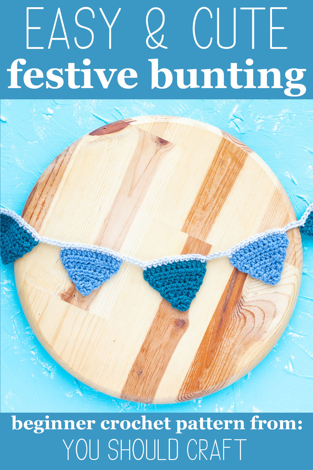 "crocheted banner on a round piece of wood with text ""easy & cute festive bunting - beginner crochet pattern from: you should craft"""