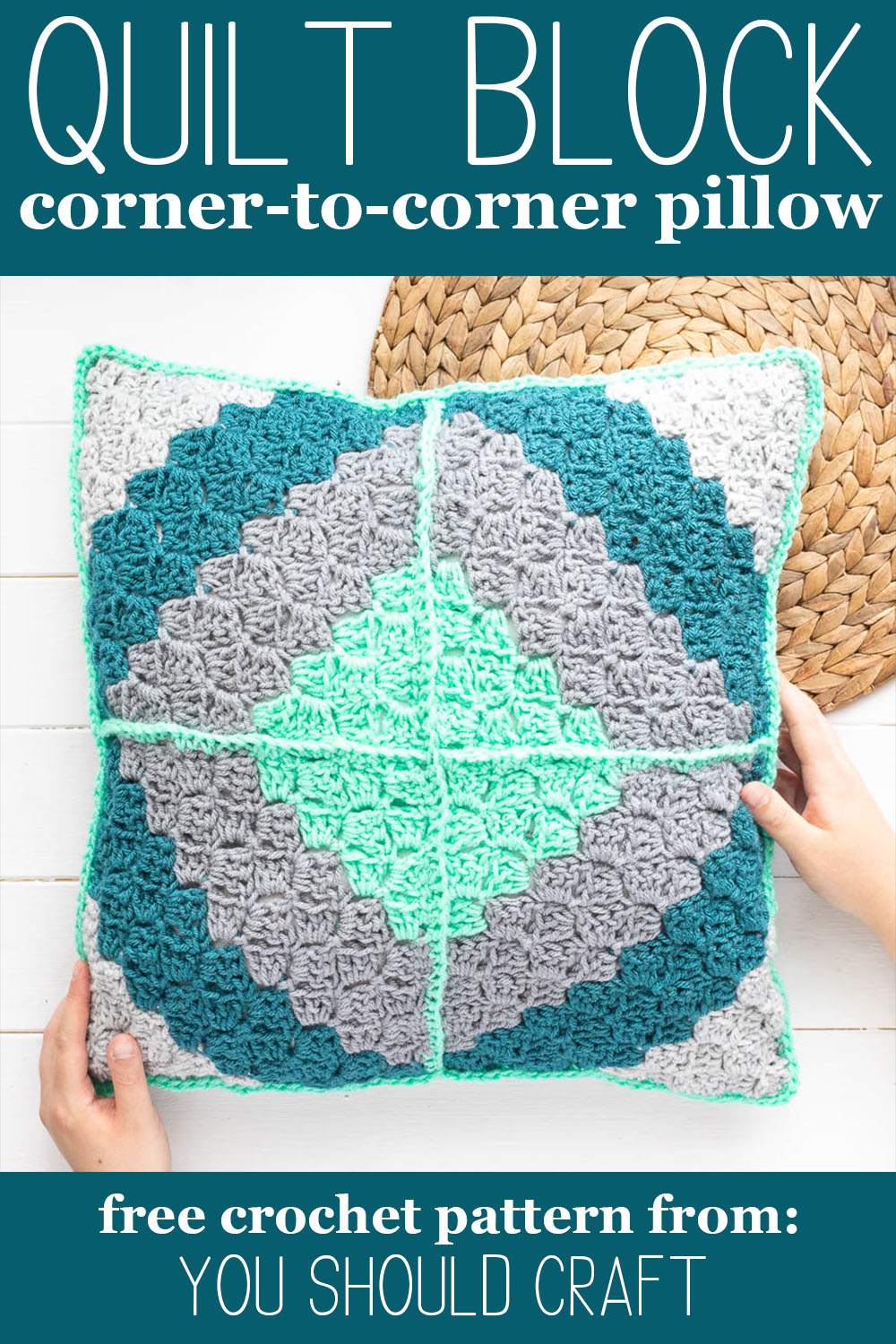 """two hands holding a teal and grey c2c crochet pillow with a diamond pattern and text """"quilt block corner-to-corner pillow -- free crochet pattern from you should craft"""""""