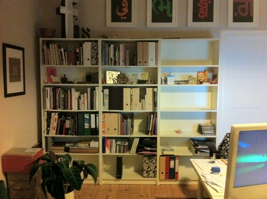 The bookshelves are slowly getting packed up