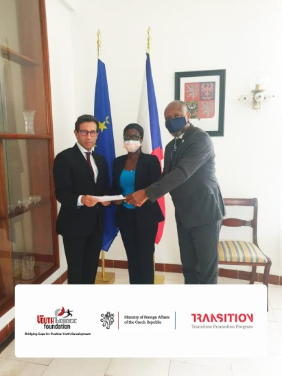 Ambassador H.E. Jan Füry (Left)  presents a copy of signed contract to the YBF Team(Right)