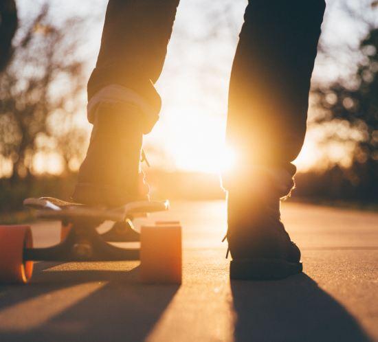 teenage fun — skateboarding at sunset